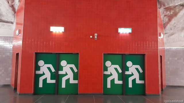 Emergency exits at the Universitetet station in striking colours.