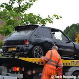 Auto beland in pekelder diep - Foto's Teunis Streunding