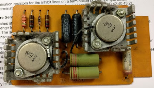 "The IBM 1401 has four ""AQW"" cards that generate currents for the core memory switches. This card had a faulty inductor (the upper green cylinder), preventing core memory from working."
