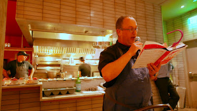 At DaNet last night, Ken Norris looks on as Chef Paley reads from friend Anya Von Bremzen's book Mastering the Art of Soviet Cooking about Salade Olivier