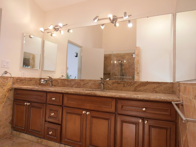 Master Bathroom - Double vanity sinks with granite countertop