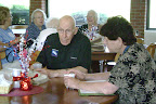 Rev. Albert W. Cylwicki enjoys breakfast discussion after celebrating the Opening Mass for the Festival of Freedom.