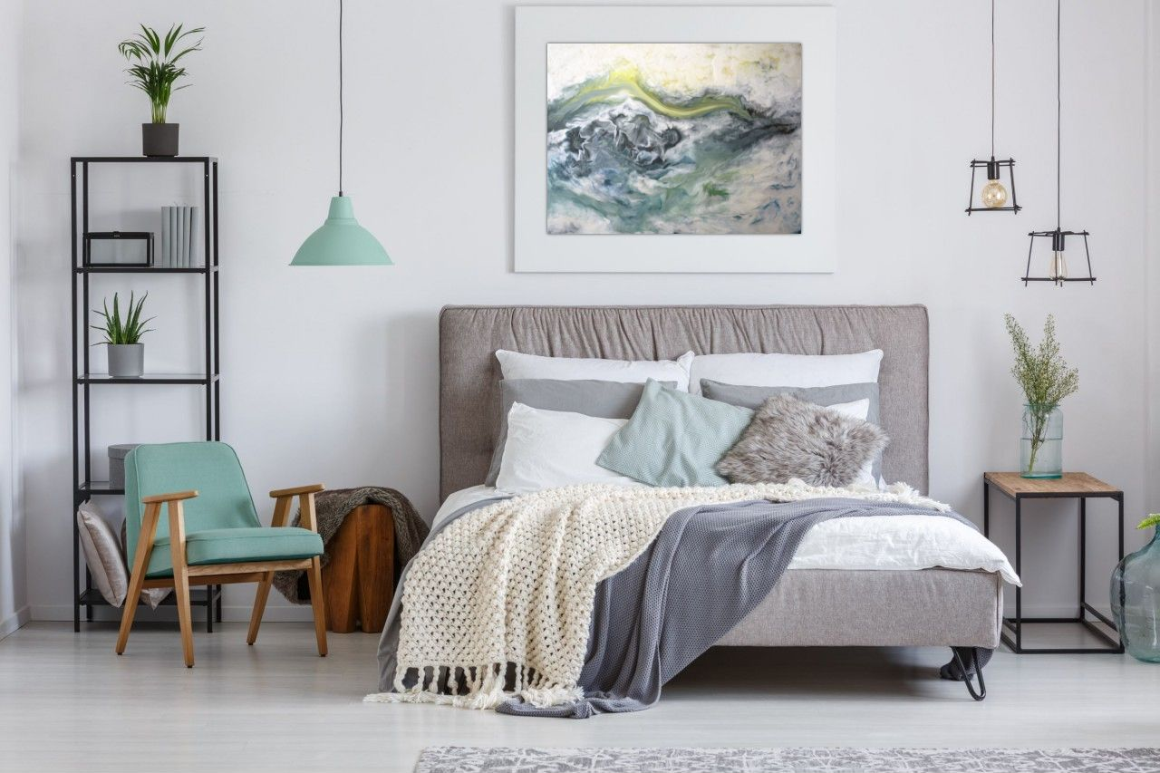 """Frozen in Time"" by Becky Black hangs in cool-toned bedroom aesthetic"