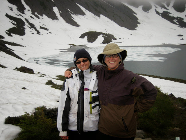 Two hikers pose infront of snow covered lakesCredit: Janell Kaufman
