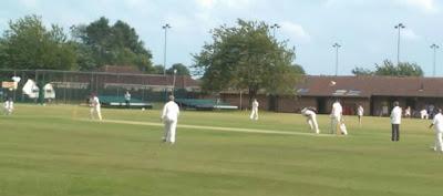 Bowler caught in mid-bowl against batsman