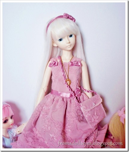 Pink lace dress for a ball jointed doll with accessories.