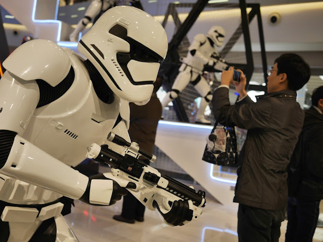 Star Wars Stormtrooper with gun and man using a camera at the IAPM shopping center in Shanghai