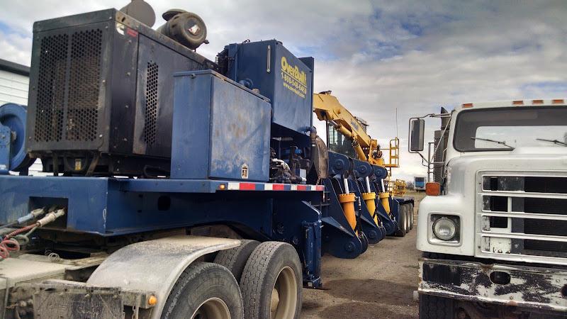 John Deer 350 excavator and metal recycling baler loaded on flatbed trailer