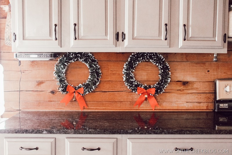 Christmas wreath on kitchen backsplash