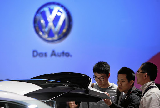 Guests look at a Volkswagen car at a car show in Shanghai. Picture: REUTERS