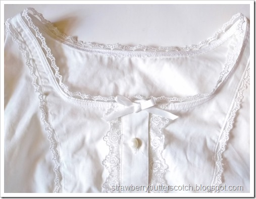 Close up of the new finished neckline for the blouse.  It has nice lace along the edge and a bow on the front.