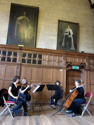 String quartet playing at a wedding in Oxford Town Hall in England