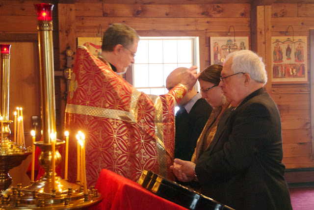 The catechumen are blessed by the priest.