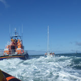 Poole ALB towing a yacht with engine and steering failure in Poole Bay on 11 May 2013. Yarmouth ALB coming alongside to take over the tow. Photo: RNLI/Poole Alex Evans