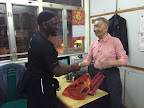 Sifu Garry Mckenzie presents Grandmaster Ip Ching with gifts.