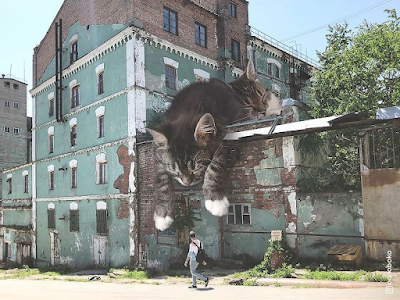 photoshopped image of giant cat by Russian artist Andrey Scherbak