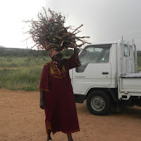 Seen in Selebi-Phikwe. Women carry a lot of things on their head.