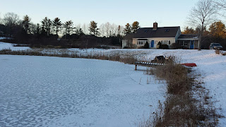 Frozen surface on our pond with swirls of snow