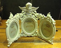 Cream triple photo frame with cherub £19.99