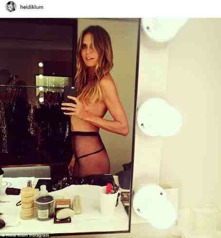 Heidi Klum Poses Topless In Selfie