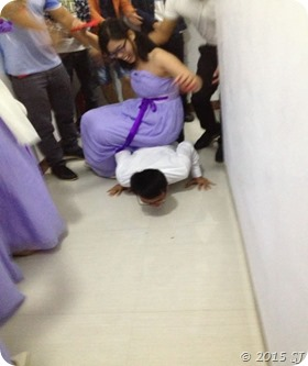 A bridesmaid sitting on the Groom's back