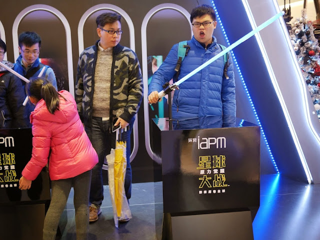 man posing with a light saber at the IAPM shopping center in Shanghai
