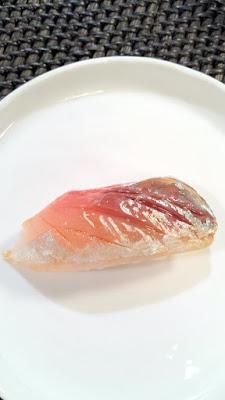 Wild Mackerel ponzu aged soy and shiso underneath fish