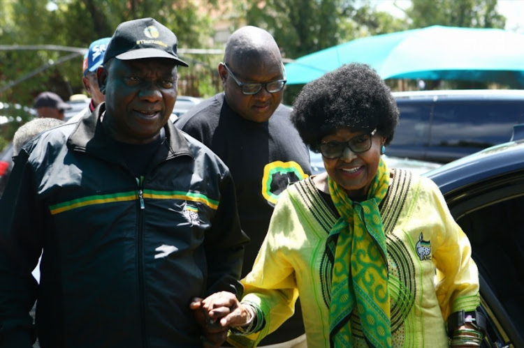 President Cyril Ramaphosa and ANC stalwart, Winnie Madikizela-Mandela during the ANC's voter registration drive on March 10, 2018 in Soweto, South Africa. Ramaphosa accompanied Madikizela-Mandela to check her voter registration details at Orland West High School voting station.