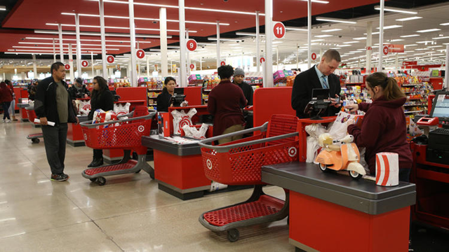 Shoppers pay for their purchases at a Chicago Target store on Friday, 24 November 2017. The cost of food, shelter and gas have all risen significantly in the past year, according to federal data. Photo: Antonio Perez / Chicago Tribune