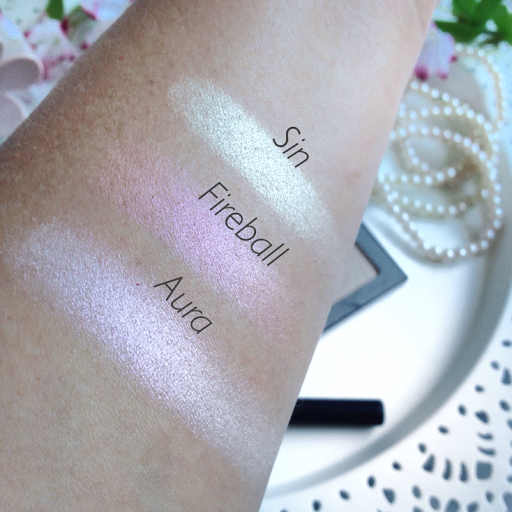 urban decay afterglow highlighter in aura, sin and fireball