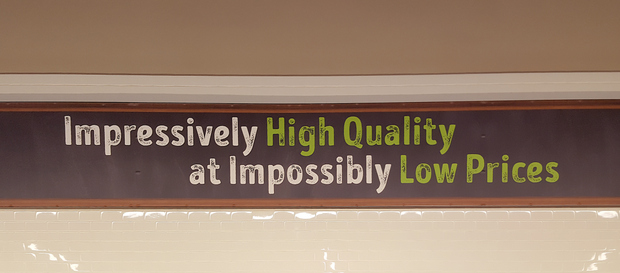 "photo of a sign inside the store that reads ""impressively high quality at Impossibly low prices"""