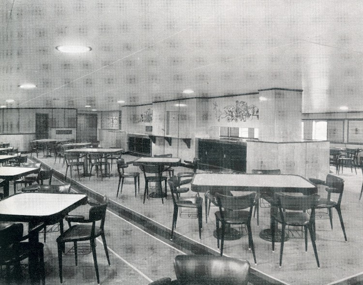 Wrought iron designs on plastic panelling are a feature of the dining saloon. From THE MARINE ENGINEER AND NAVAL ARCHITECT.jpg