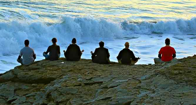 A group of people sit perched near the edge of a cliff at Steamer Lane in Santa Cruz on Saturday evening, 20 February 2016. California is going through a long dry spell this winter, but that's not unusual even in El Niño years. Photo: Fred Arellano / Vintage Rock Photography