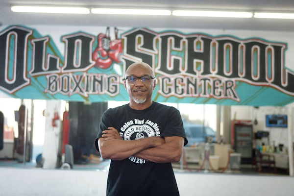 Ernest Johnson, owner of the Old School Boxing and Fitness Center, stands proud in front of his gym.