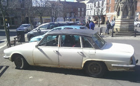 white rusty four door in car park