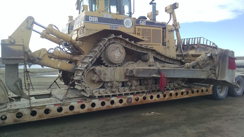 D8 CAT bulldozer loaded on flatbed trailer
