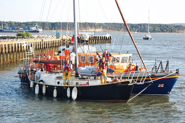Coxswain Jonathan Clark turning the lifeboat and alongside yacht to go astern (reverse) into Poole Quat Boat Haven 22 August 2013 Photo credit: RNLI/Dave Riley