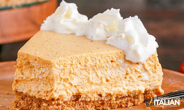 No Bake Pumpkin Cheesecake slice with whipped cream around the edge