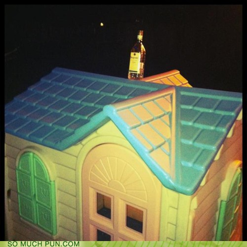 Photo of a bottle of booze on top of a doll house...drinks are on the house