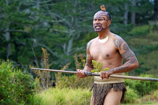 Maori warrior performing a wero