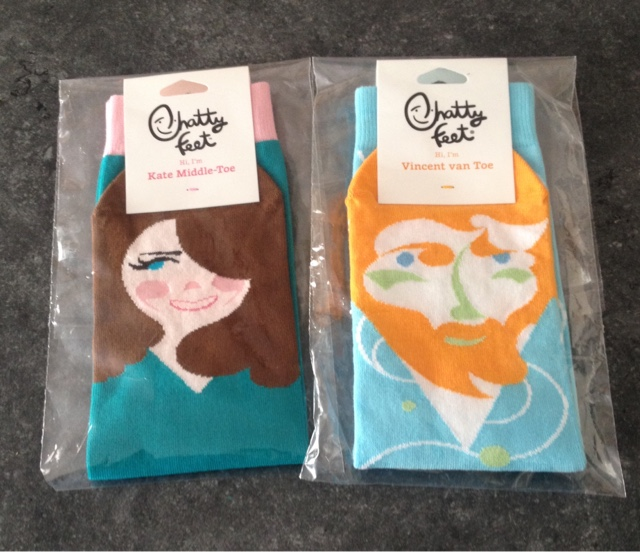 Kate Middle -Toe and Vincent van Toe Chattyfeet socks in plastic wrappers