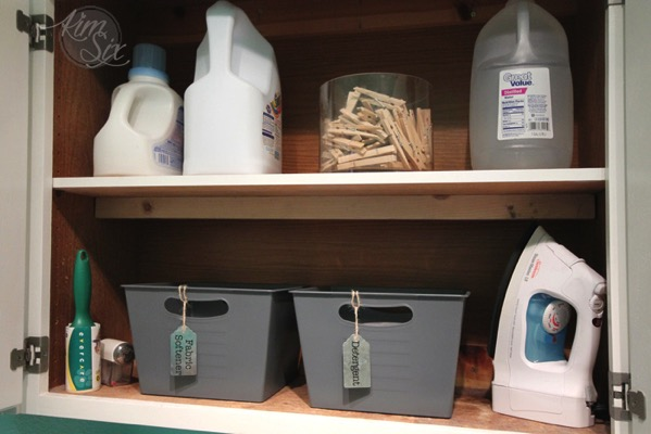 Laundry room storage in cabinets