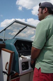 A photo of myself sailing the boat on the Ohio River on July 23, 2006. Photo courtesy of Nick Peyton.
