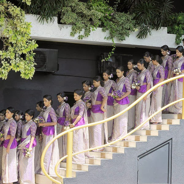 Sri Lankan bridesmaids take part in the Guinness World Record-breaking wedding of unseen couple Nisansala and Nalin in Negombo, some 30kms north of Colombo, on November 8, 2013. Including 126 bridesmaids, 25 best men, 20 page boys and 23 flower girls the wedding breaks the previous record, held by a wedding in Bangkok that included 96 bridesmaids, of most bridesmaids to one bride.