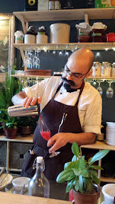 Chef Ricardo pours the Watermelon Mint Juice, the first of the housemade non-alcoholic drink flight