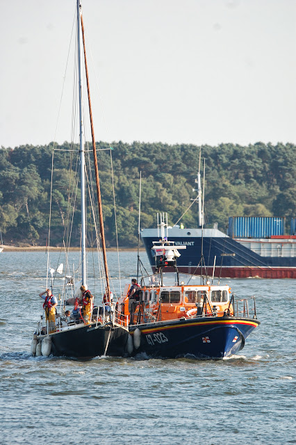 Poole ALB with the yacht in an alongside tow bringing her into Poole Quay Boat Haven 22 August 2013 Photo credit: RNLI/Dave Riley