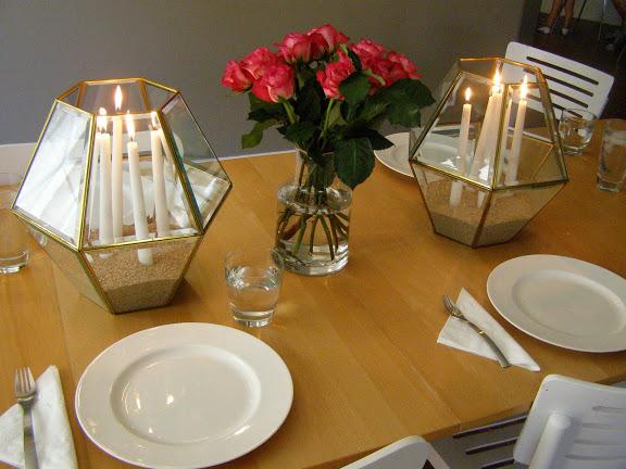 Lanterns as centerpiece candleholders