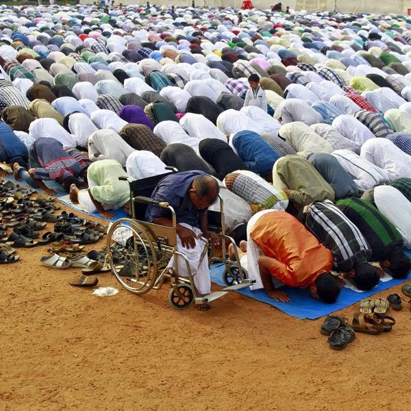 Muslims offer Eid prayers at a playground in Kochi, one of the main cities of the southern Indian state of Kerala.