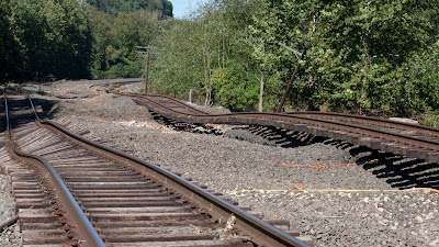 Twisted train tracks behind Dave's Sport Shop south of Sloatsburg, Ramapo River