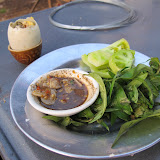 Duck embryo eaten with pepper/salt/garlic sauce, green tomatoes and herbs